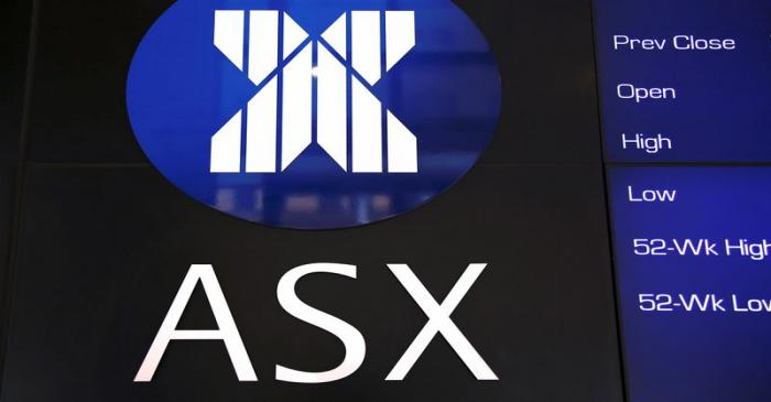 A board displaying stock prices is adorned with the Australian Securities Exchange (ASX) logo