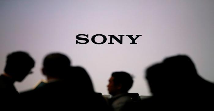 Journalists wait for Sony Corp's new President and Chief Executive Officer Kenichiro Yoshida's