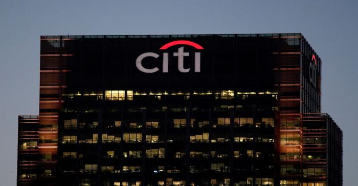 FILE PHOTO: Workers are seen in Citibank offices in the Canary Wharf financial district in