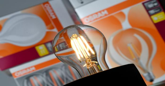 FILE PHOTO: Picture illustration of a lightbulb and lightbulb packaging of German manufacturer