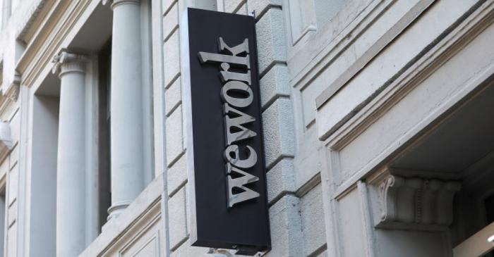 FILE PHOTO: A sign is seen above the entrance to the WeWork corporate headquarters in