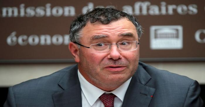 FILE PHOTO: Total CEO Patrick Pouyanne attends a hearing of French parliament's economic