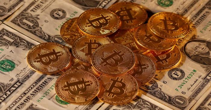 Representations of virtual currency Bitcoin and U.S. dollar banknotes are seen in this picture