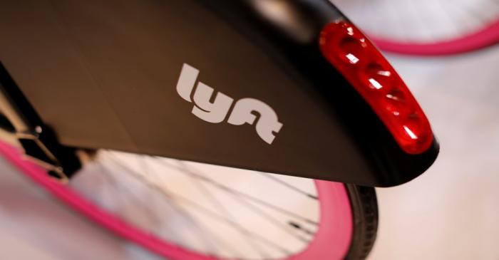 FILE PHOTO: A Lyft bicycle is shown at the Lyft listing on the Nasdaq during an IPO event in