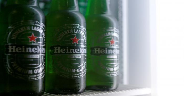 Botttles of Heineken lager beer are seen in a picture illustration inside a refrigerator in