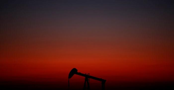 An oil pump is seen just after sunset outside Saint-Fiacre
