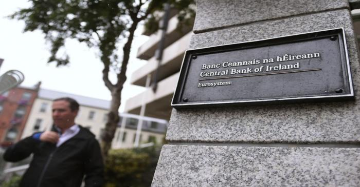 FILE PHOTO:  A man walks past the Central Bank of Ireland in Dublin