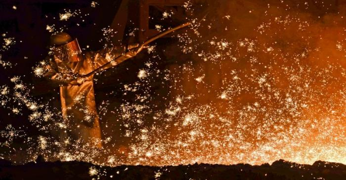 A steel-worker is pictured at a furnace at the plant of German steel company Salzgitter AG in
