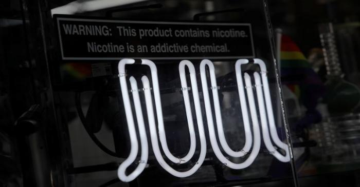 Signage for Juul vaping products is seen on a storefront in New York City