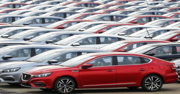 FILE PHOTO:  Cars for export wait to be loaded onto cargo vessels at a port in Lianyungang