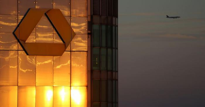 FILE PHOTO: The logo of Germany's Commerzbank is seen in the late evening sun on top of its