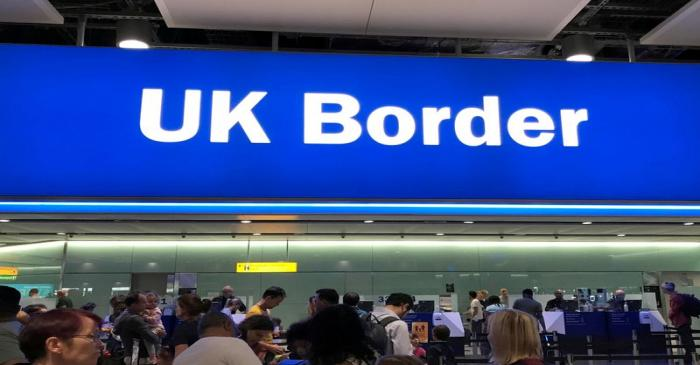 FILE PHOTO: Signage is seen at the UK border control point at the arrivals area of Heathrow