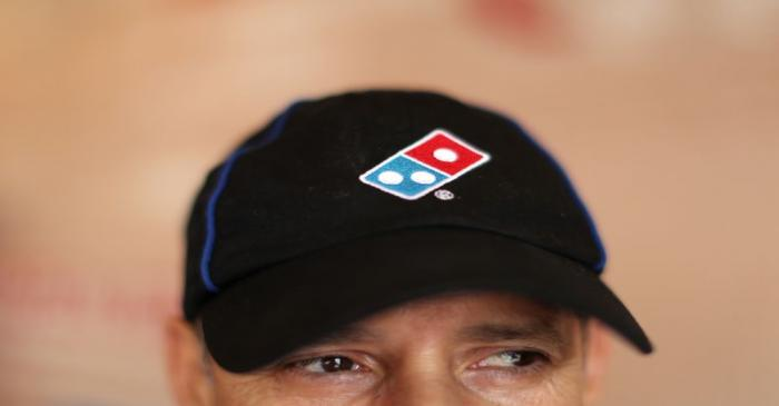 A Domino's Pizza employee works in a restaurant in Los Angeles