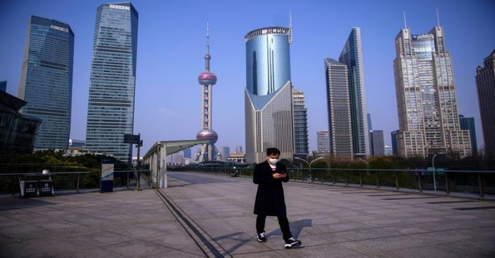 FILE PHOTO: A man wearing a mask is seen at Lujiazui financial district in Pudong, Shanghai