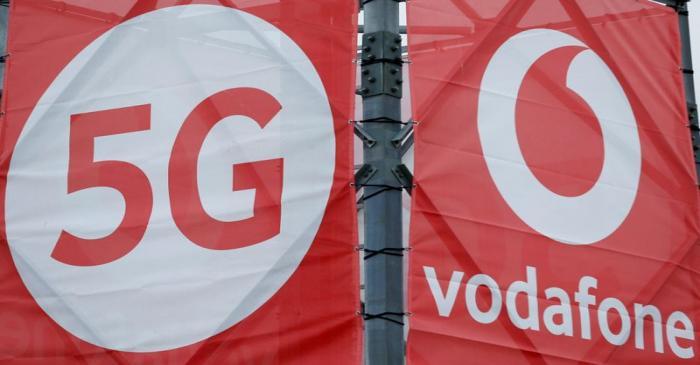 FILE PHOTO: Logos of 5G technology and telecommunications company Vodafone