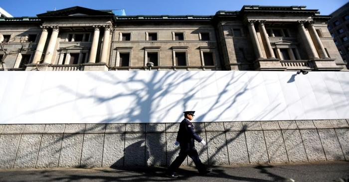 A security guard walks past the front of the Bank of Japan headquarters in Tokyo