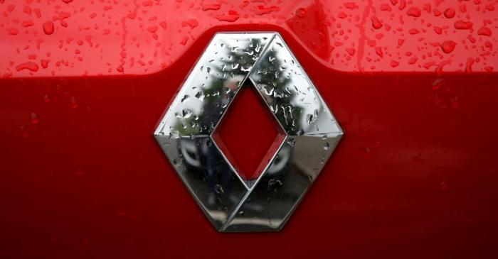 The logo of French car manufacturer Renault is seen on a car at a dealership of the company in