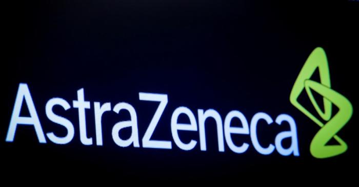 FILE PHOTO: The company logo for pharmaceutical company AstraZeneca is displayed on a screen on