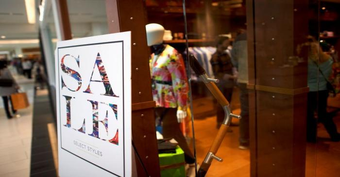 A sale sign is positioned outside the Robert Graham store of the King of Prussia Mall, United
