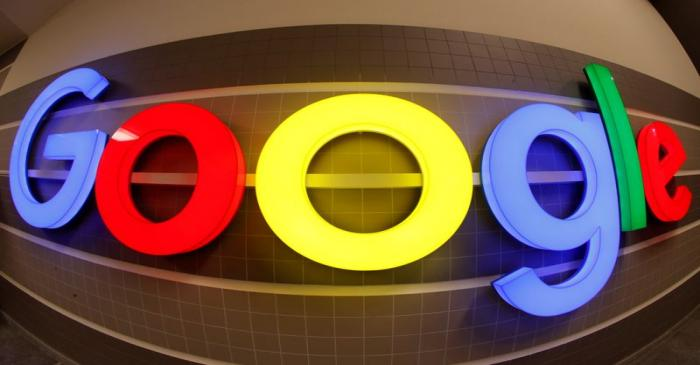 FILE PHOTO: An illuminated Google logo inside an office building in Zurich