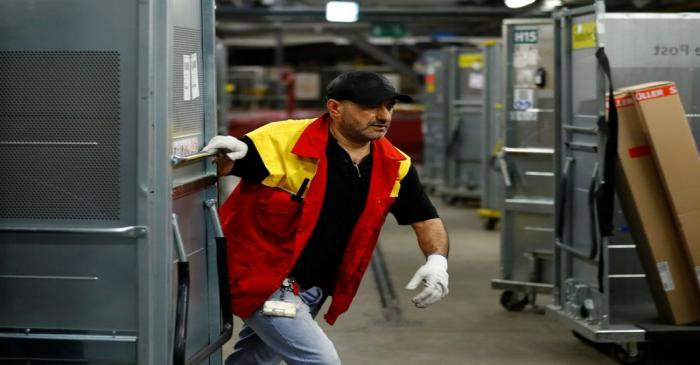 An employee works at a distribution centre of German postal and logistics group Deutsche Post