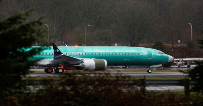 A Boeing 737 Max aircraft taxis the runway at the Renton Municipal Airport in Renton