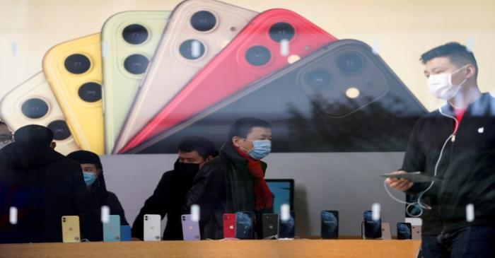 FILE PHOTO: People wearing protective masks are seen in an Apple Store, as China is hit by an