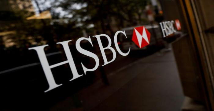 FILE PHOTO: HSBC logos are seen on a branch bank in the financial district in New York
