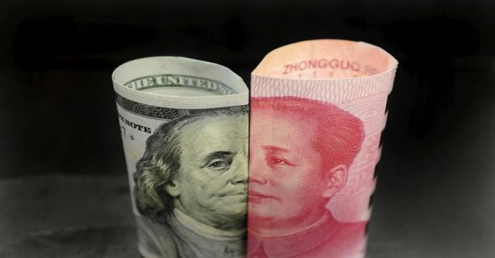 FILE PHOTO: A Benjamin Franklin U.S. 100 dollar banknote and a Chinese 100 yuan banknote with