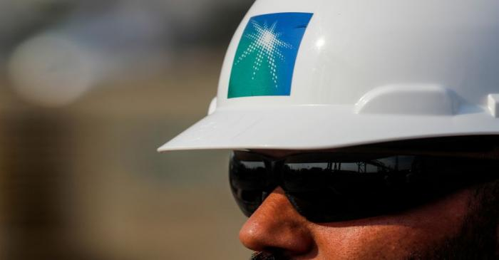 FILE PHOTO: An employee in a Saudi Aramco branded helmet
