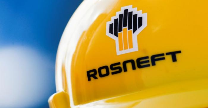 FILE PHOTO: Rosneft logo is pictured on a safety helmet in Vung Tau