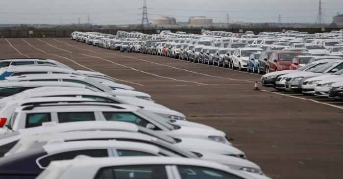 Imported cars are parked in a storage area at Sheerness port, Sheerness