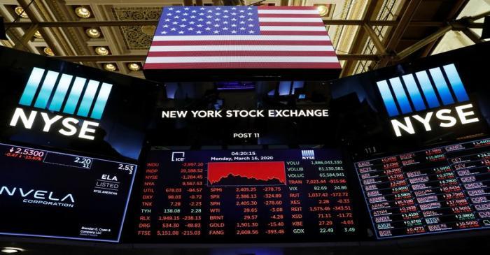 Traders work on the floor of the New York Stock Exchange shortly as coronavirus disease
