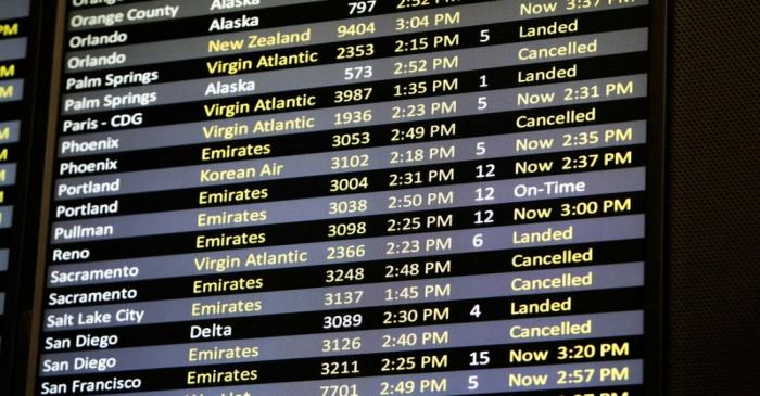 FILE PHOTO: Several canceled flights are pictured on a monitor at Seattle-Tacoma International