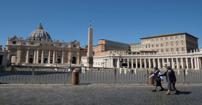 FILE PHOTO: Nuns walk past a deserted St Peter's Square in Rome