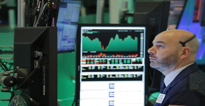 A trader works on the floor of the New York Stock Exchange shortly before the closing bell in