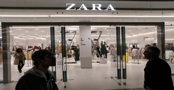 FILE PHOTO: People shop at a Zara store during the grand opening of The Hudson Yards