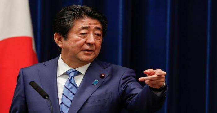 Japan's Prime Minister Shinzo Abe gestures as he speaks during a news conference on Japan's