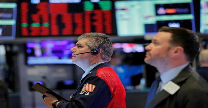 FILE PHOTO: Traders work on the floor of the New York Stock Exchange shortly after the opening