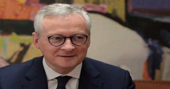 FILE PHOTO: French Finance Minister Bruno Le Maire looks on during a meeting with his Greek