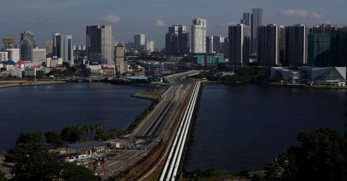 A view of the empty Woodlands Causeway between Singapore and Malaysia after Malaysia imposed a