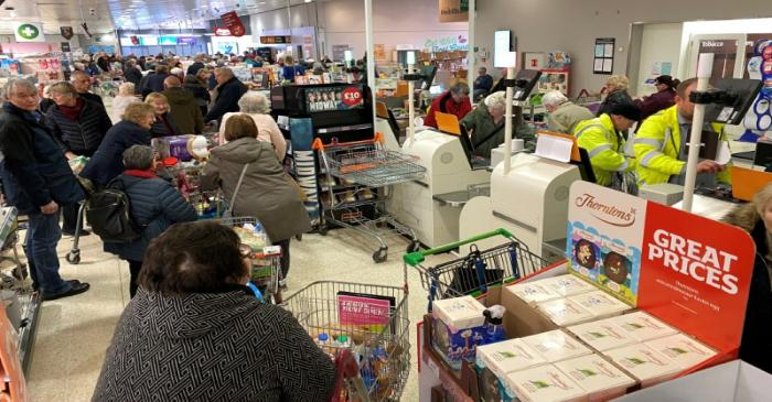 FILE PHOTO: Shoppers inside a Sainsburys supermarket in Watford