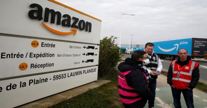 Amazon employees on strike gather outside the Amazon logistics center in Lauwin-Planque