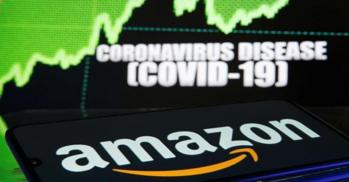 Amazon logo is seen in front of diplayed coronavirus disease (COVID-19)