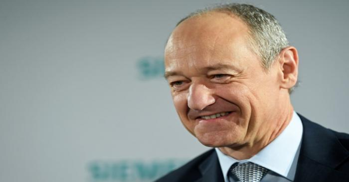 German engineering group Siemens deputy CEO Roland Busch attends a news conference prior to the