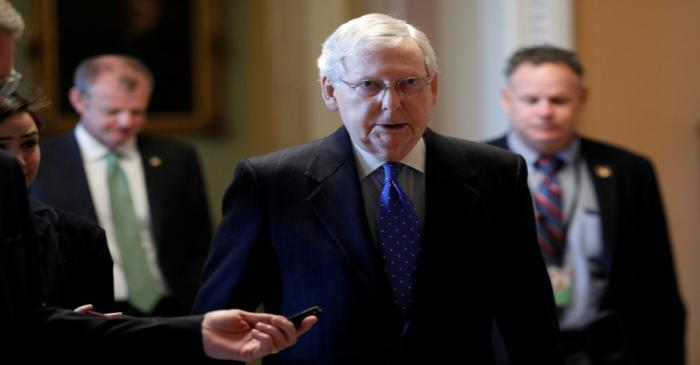 Senate Majority Leader McConnell speaks to members of the news media while walking into his