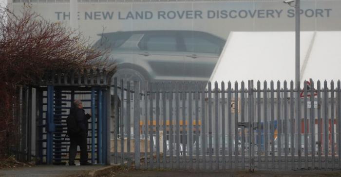 A worker arrives at Jaguar Land Rover's Halewood Plant in Liverpool