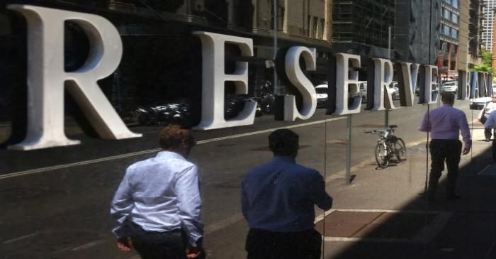 Pedestrians walk past the Reserve Bank of Australia building in central Sydney