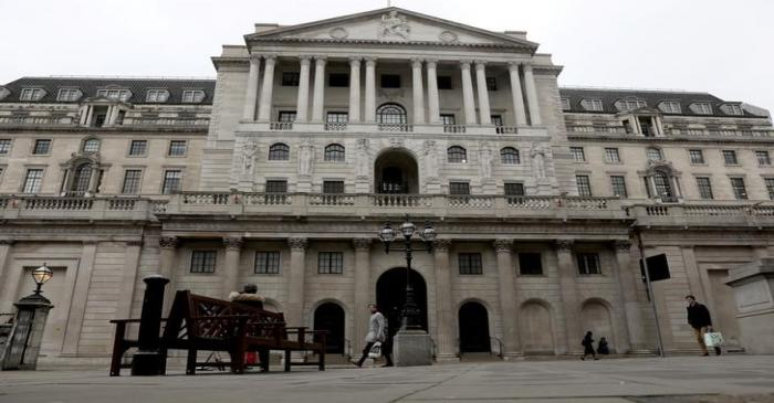 People walk in front of the Bank of England, as the number of coronavirus disease (COVID-19)