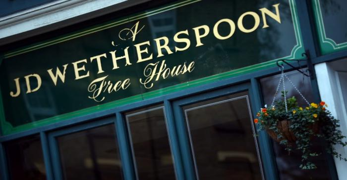 A Wetherspoon's logo is seen at a pub in central London